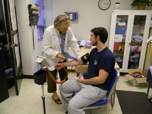 Nurse Elaine Zarichnak takes sophomore Brandon Short's blood pressure  during office hours in the athletics building. (Photo by Alexandra Smith)