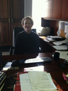 Dr. Andrea Adolph, Director of Academic Affairs at Penn State New Kensington, works at her desk on campus. (Photo by Eric Bennardo)