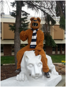 The Penn State New Kensington Lion mascot sits atop the Nittany Lion Shrine.