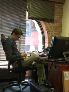 Zachary Mullaney works in his office at Burns White LLC in downtown Pittsburgh. (Photo by Casey Domski)
