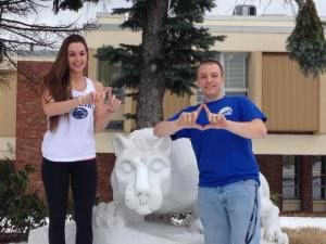 Brooke Churma and Alex Pedder pose with the Nittany Lion as they generate enthusiasm for the upcoming THON weekend. (Photo by Lauren Blum)