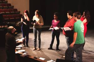 """Bill Mitas works with students at auditions for """"Into the Woods"""" (Photo by Jon McCabe)"""