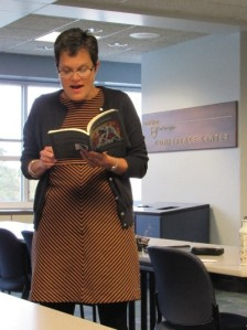 Julia Kasdorf reads from one of her published books of poems during a presentation at Penn State New Kensington on October 14. (Photo by: Sarah Steighner)